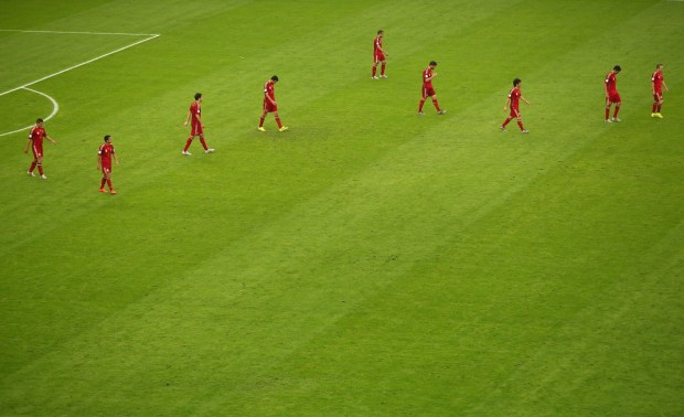 a-dejected-spain-walks-off-the-pitch-after-losing-to-chile