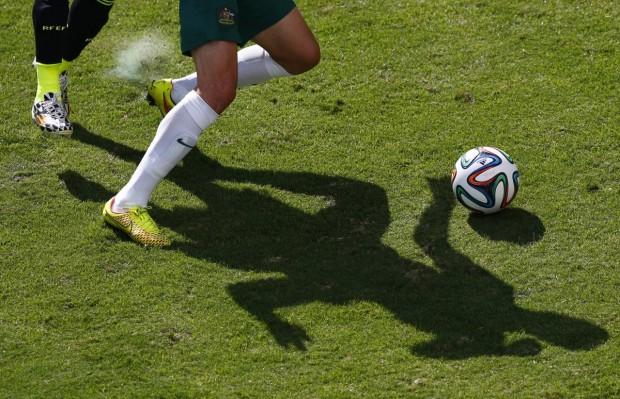 australias-ryan-mcgowan-and-spains-jordi-albas-shadows-fight-for-the-ball