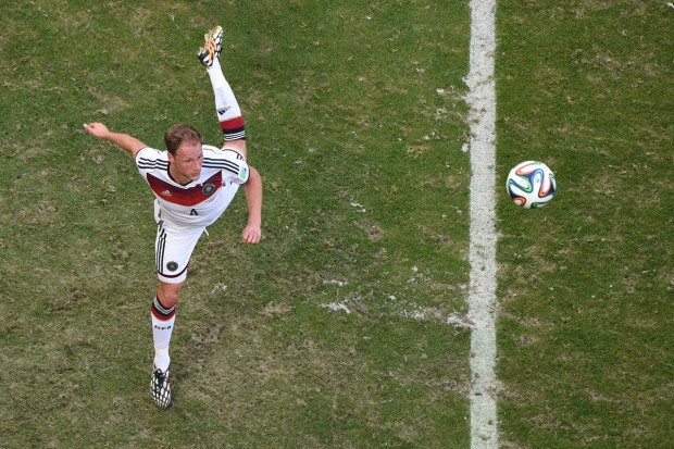 benedikt-hoewedes-of-germany-leaps-to-head-the-ball-in-a-game-against-portugal