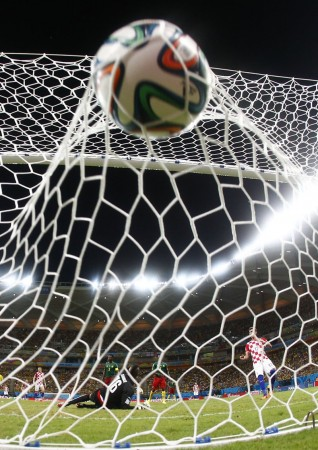 cameroons-goalkeeper-charles-itandje-lets-a-croatia-goal-fly-by-him-in-the-net