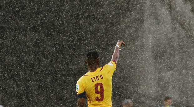 cameroons-samuel-etoo-points-to-his-teammate-as-the-rain-pours-down-in-natal