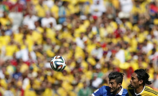 greeces-panagiotis-kone-and-colombias-abel-aguilar-fight-for-the-ball