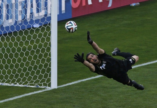 irans-goalie-alireza-haghighi-tries-and-fail-to-save-a-messi-goal