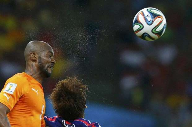 ivory-coasts-didier-zokora-heads-a-ball-away-from-a-japanese-player