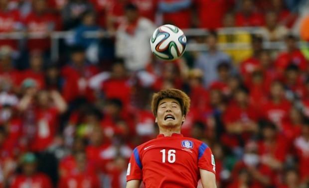 ki-sung-yueng-of-south-korea-heads-the-ball