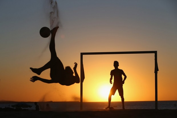 locals-play-soccer-at-sunset-on-a-beach-in-fortaleza-brazil