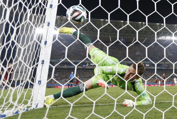 russian-goalie-igor-akinfeev-drops-a-ball-into-the-net-allowing-a-goal-for-south-korea
