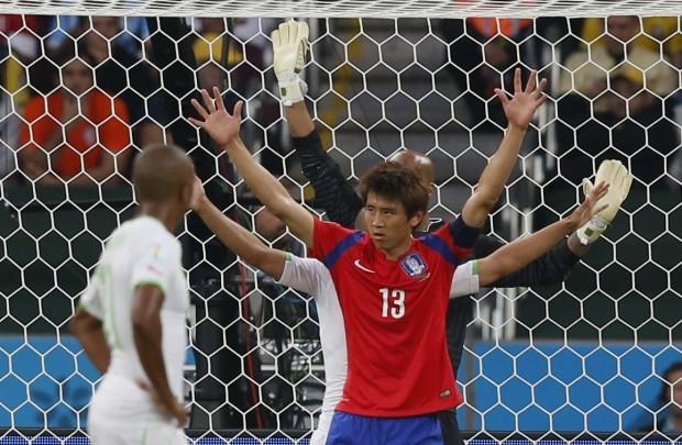 south-koreas-koo-ja-cheol-celebrates-his-goal-as-alergias-defenders-raise-their-arms-in-disbelief