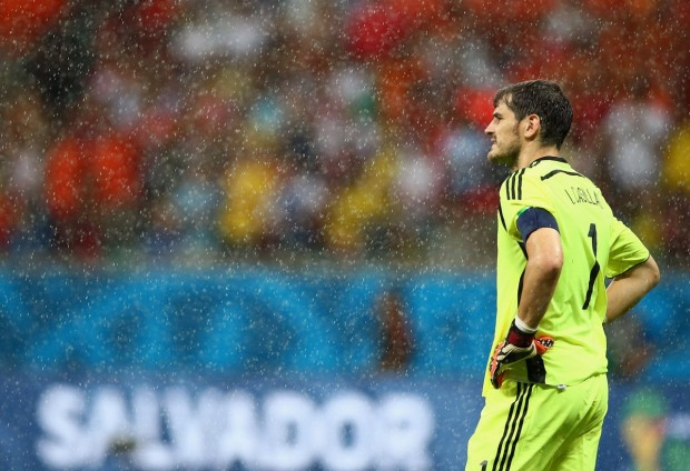 spains-goalie-iker-casillas-looks-on-as-the-rain-pours
