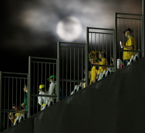 the-moon-shines-bright-as-fans-get-ready-to-leave-the-stadium-after-the-opening-game