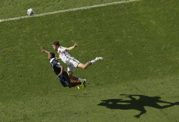 thomas-mueller-of-germany-and-patrice-evra-of-france-fight-to-win-a-header-during-their-quarterfinal-match