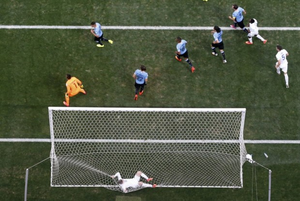 wayne-rooney-gets-caught-in-the-net-after-missing-a-shot-against-uruguay